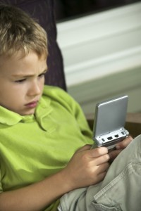 Boy Playing a Video Game